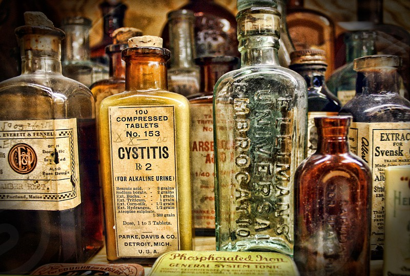 Vintage medicine bottles with their labels. photo