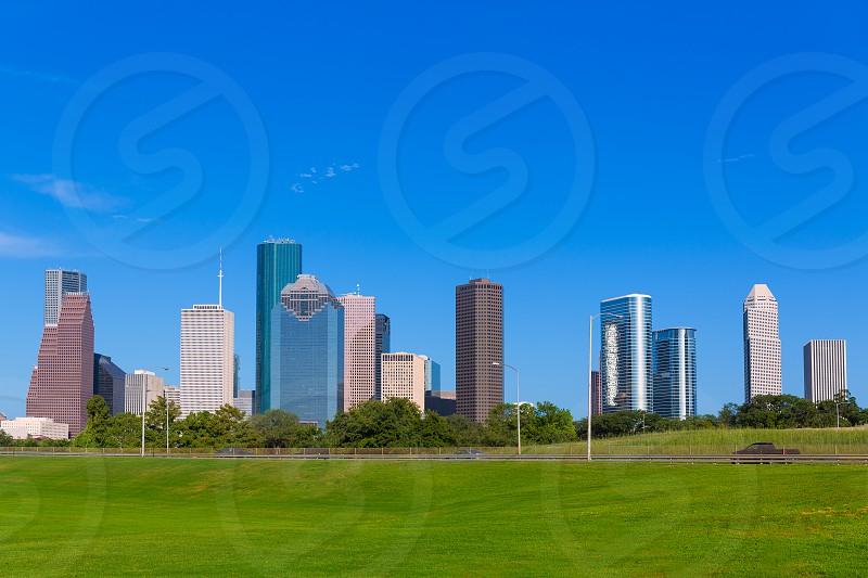 Houston skyline blue sky and Memorial park turf at Texas USA US photo