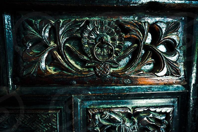 closeup photo of floral embossed door knocker photo