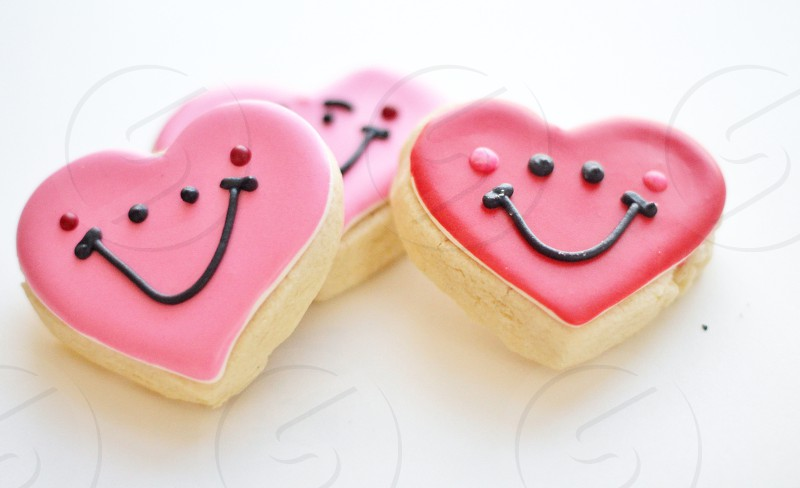 Cute red and pink happy heart smiley face cookies for valentine's day. photo