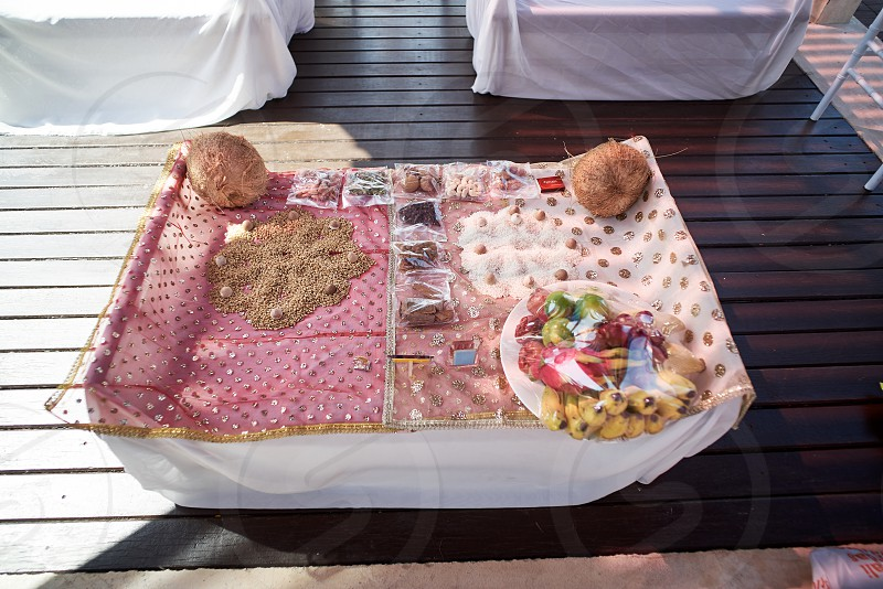 The prayer and worship items for thread ceremony pooja (Puja) of the Indian wedding before wedding ritual. Focused on the tray of red and orange power photo