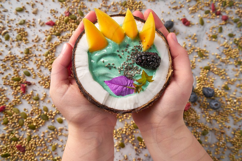 Spirulina bowl smoothie in coconut blackberry mango and chia seeds photo