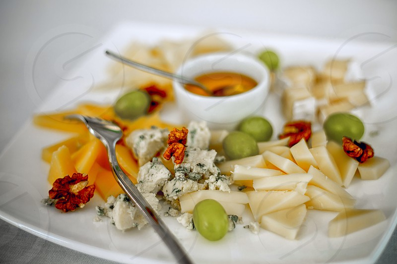 Cheese plate grapes blue french ceramic white dorbluecamamber Bri restaurant  delicious snacks snacking  photo