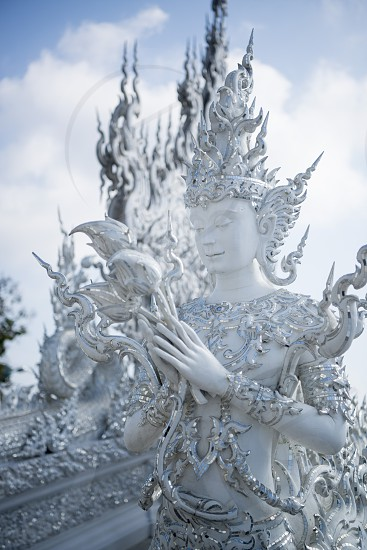 the wat rong khun or white temple near the city Chiang Rai in North Thailand. photo