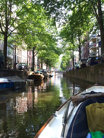 Boating through the canals in Amsterdam is a favourite pastime of locals and tourists alike! The canals in the Old City Centre of Amsterdam are a UNESCO World Heritage site.  photo