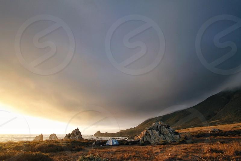 gray black mountain near white camping tent photo