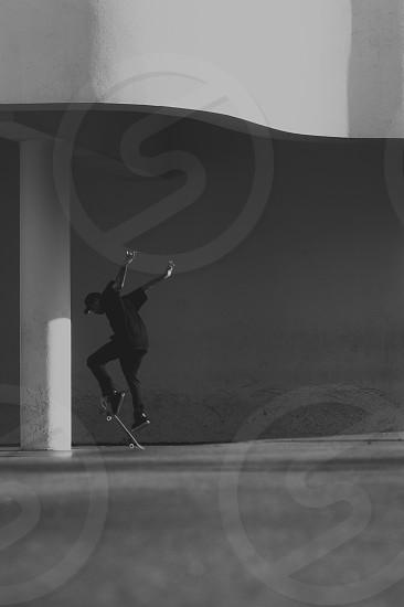 skateboarder skateboarding skateboard museum minimal black and white action shot skateboard trick skate skater photo