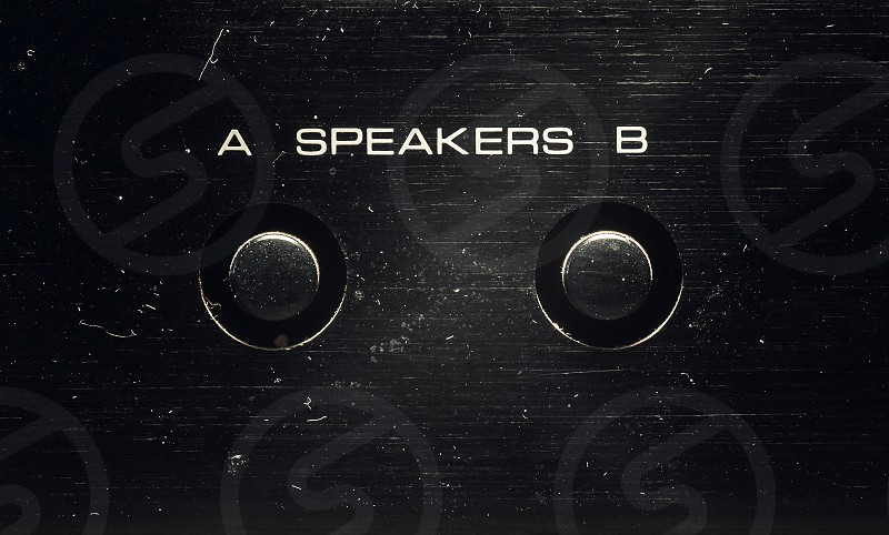 Details of an old amplifier a and b sets of speakers buttons.  photo