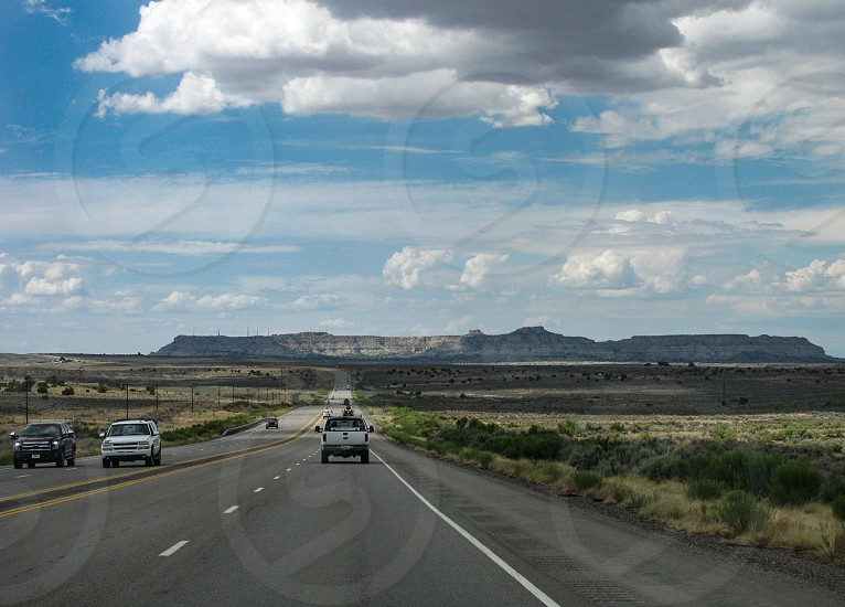 Westbound on U.S. Route 550 in New Mexico heading toward Huerfano Mesa near Chaco Culture National Historical Park and the De-Na-Zin Wilderness area. photo