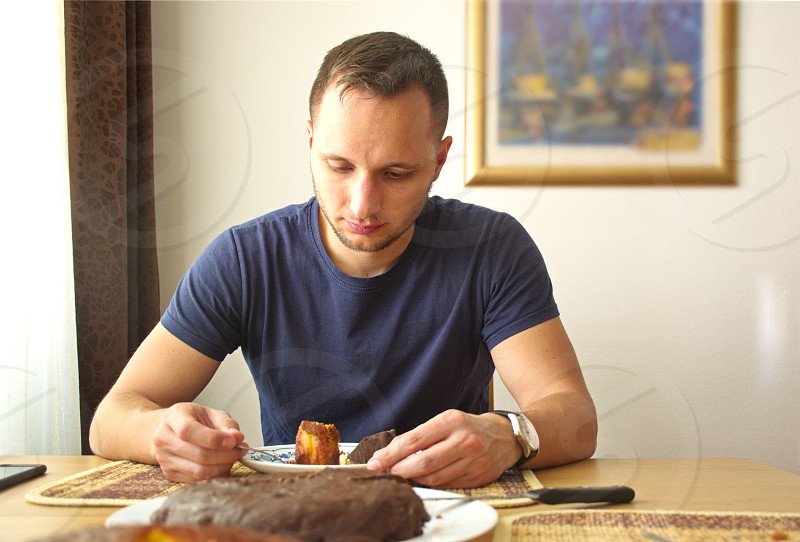 Portrait of the young man having lunch photo