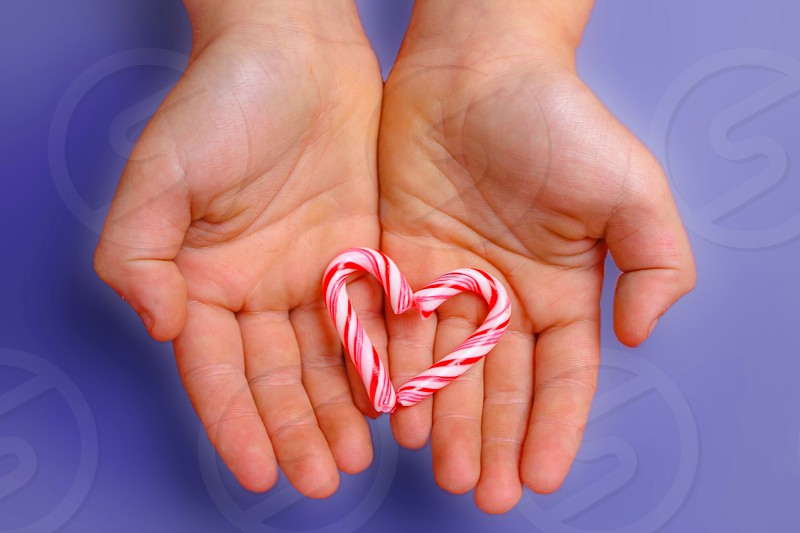 Candy cane Xmas treat heart hands kids holding candy sweet  photo