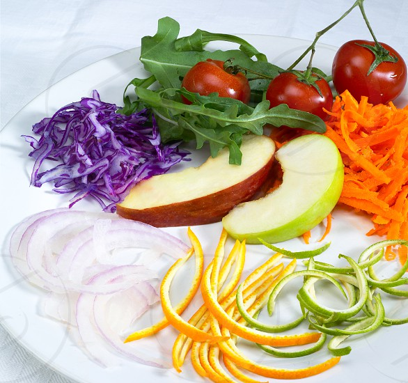 fresh salad ingredient prepared cutted on a plate  photo