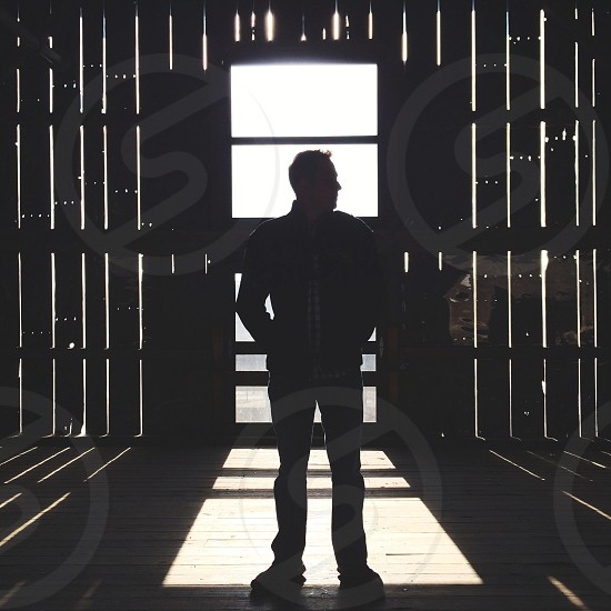 man standing inside a warehouse photo