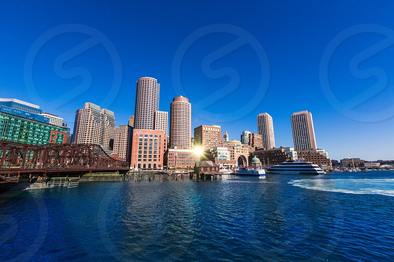 Boston skyline from Fan Pier at sunlight in Massachusetts USA photo