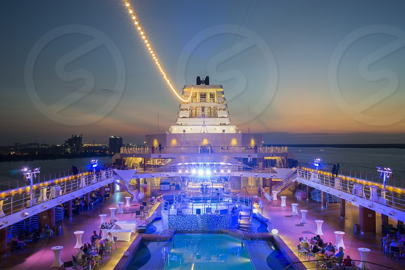 View of front deck of cruise ship sailing during sunset  photo