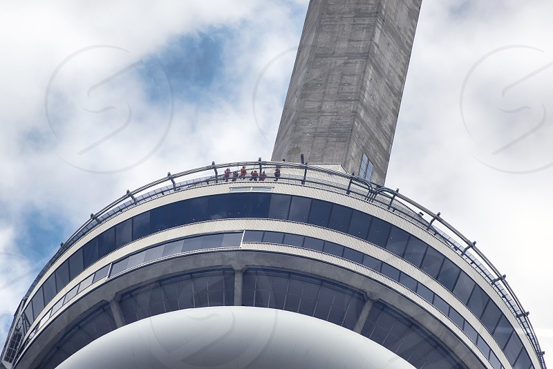 Group of people participating in the Edge Walk on the Cn Tower in Toronto Canada. photo