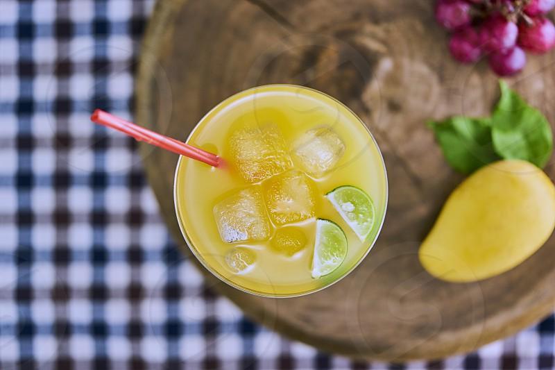 Fresh mango cocktail with mango fruit photo