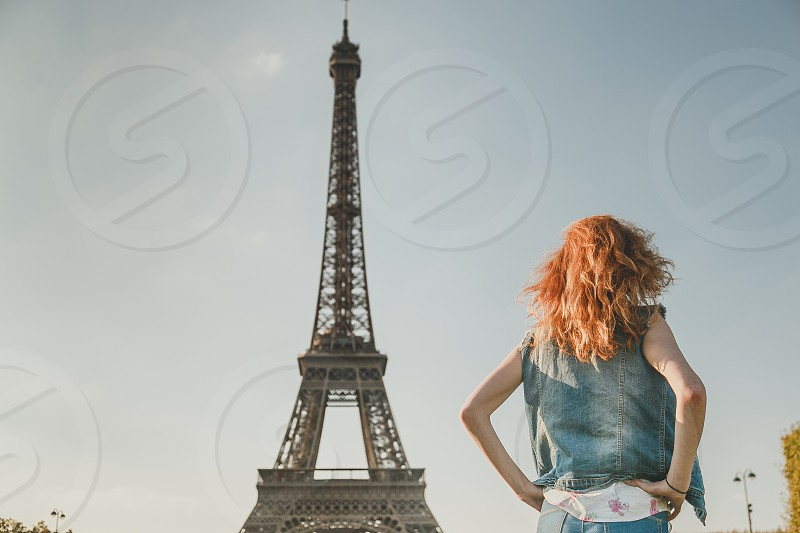 girl tower eiffel paris red hair posing france famous back travel sunset tourism skyline jeans fashion city landmark summer beautiful photo