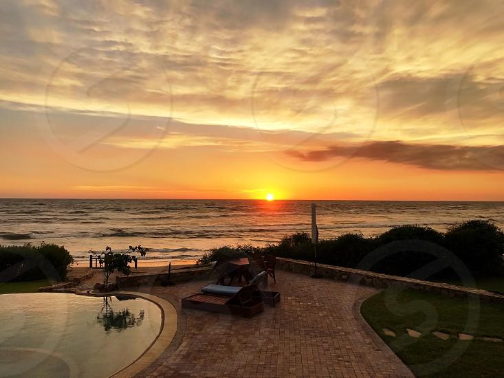 Sinaloa Mexico vibrant sunset and reflective clouds  photo