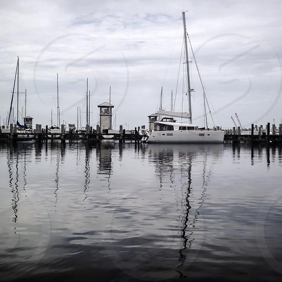 white sail ship in pier photo
