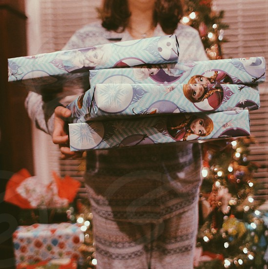 woman carrying 4 christmas presents photo