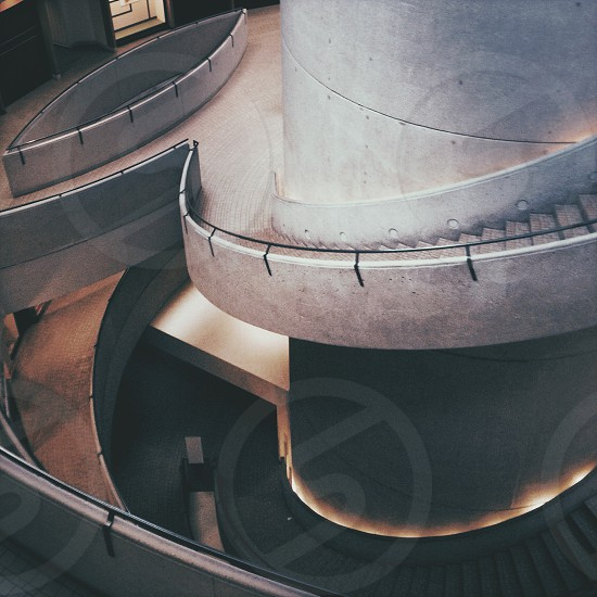 gray concrete spiral stairs  photo