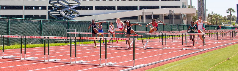 seven athletes running and jumping through obstacles during daytime photo