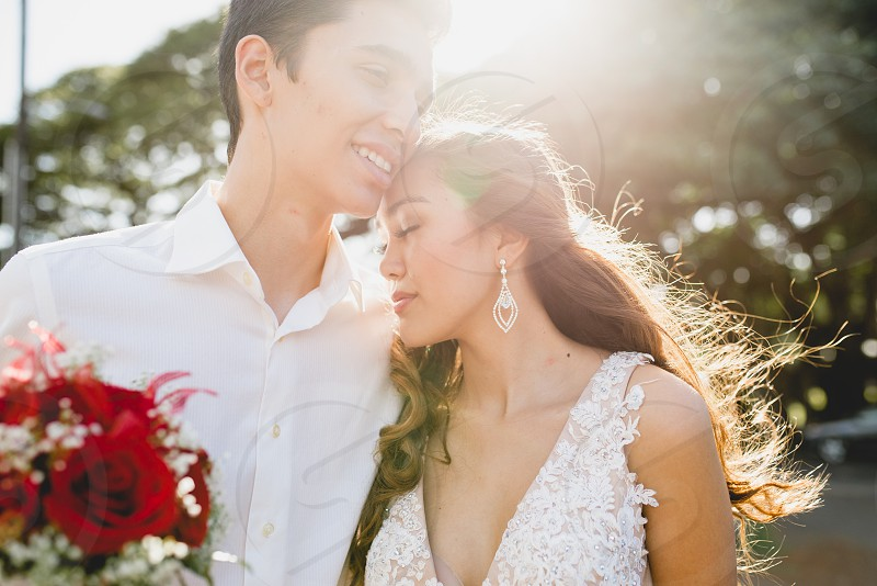 A couple cherishing their love together on the island of Oahu. photo