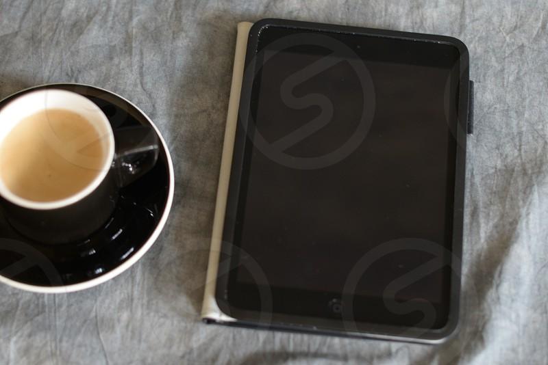 Ipad and coffee photo