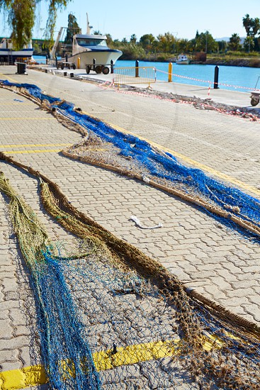 Cullera port fishing nets in Xuquer Jucar river of Valencia Spain photo