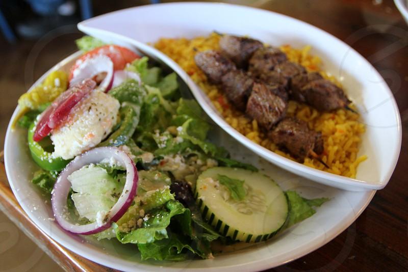 Beef kebabs with Greek salad photo