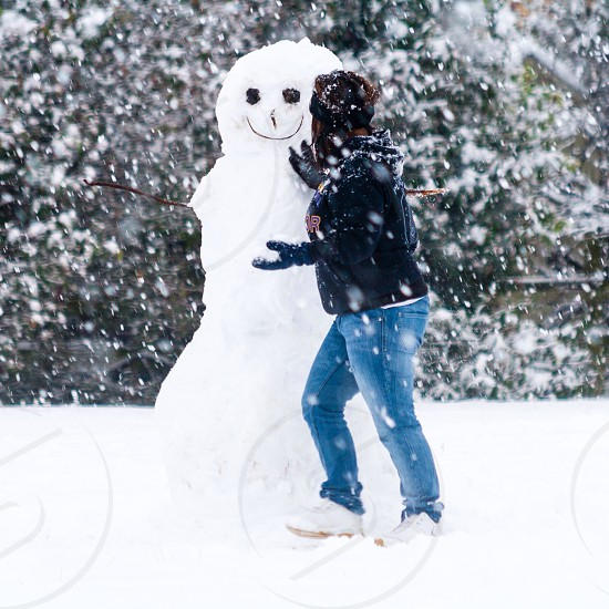 woman and snowman photo