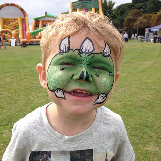 young boy with his face painted photo