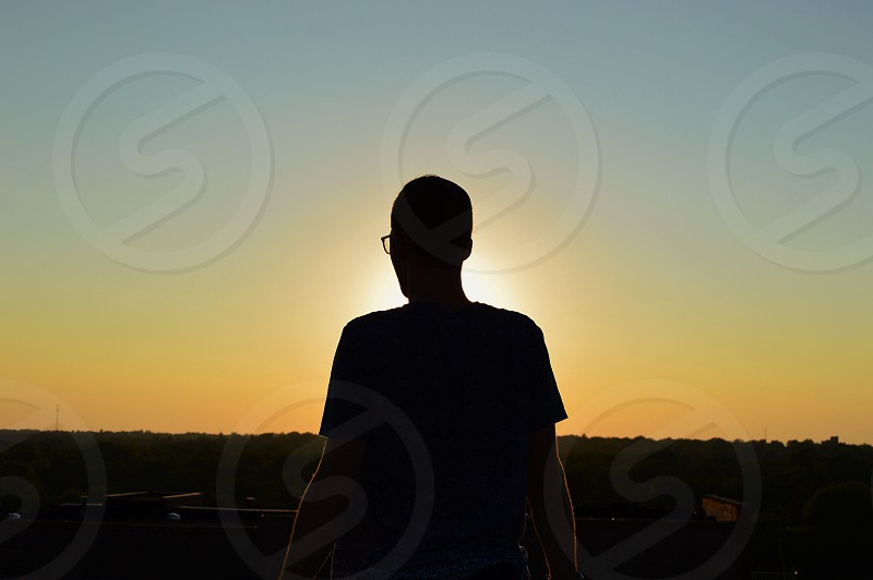 silhouette of person at sunset photo