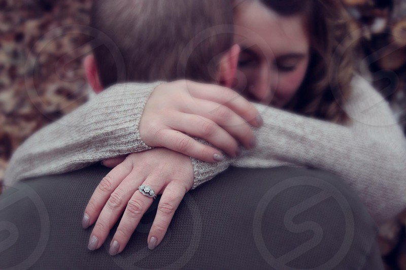 man and woman hugging photo