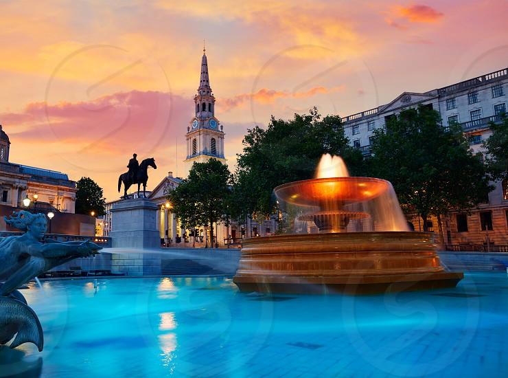 London Trafalgar Square fountain at sunset England photo