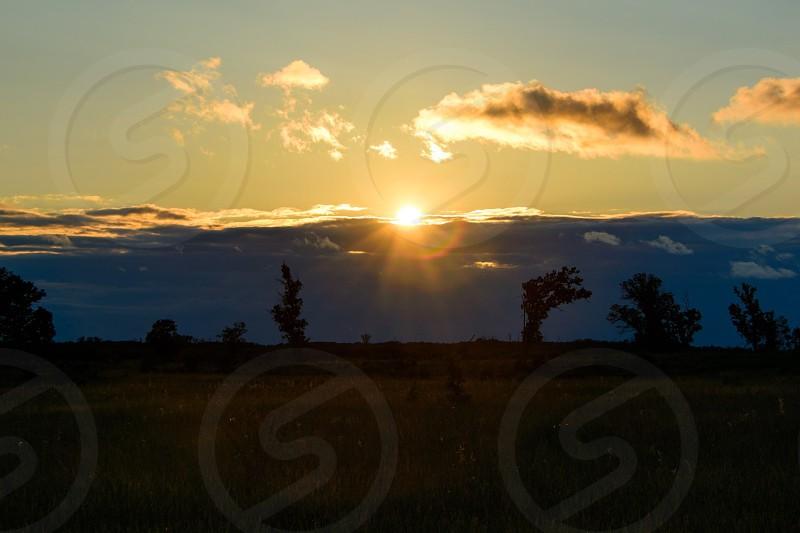 Sun setting at Sherburne National Wildlife Refuge in Minnesota.   photo
