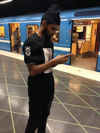man's black skinny jeans photo
