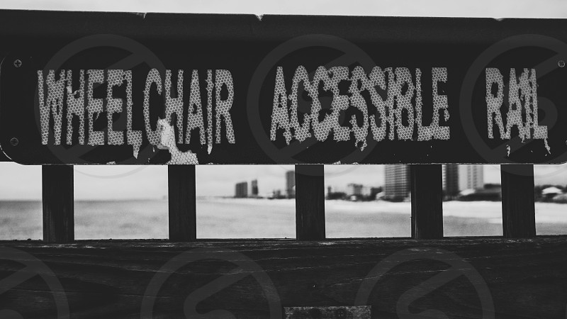 Wheelchair accessible rail sign on the pier of Panama City Beach photo