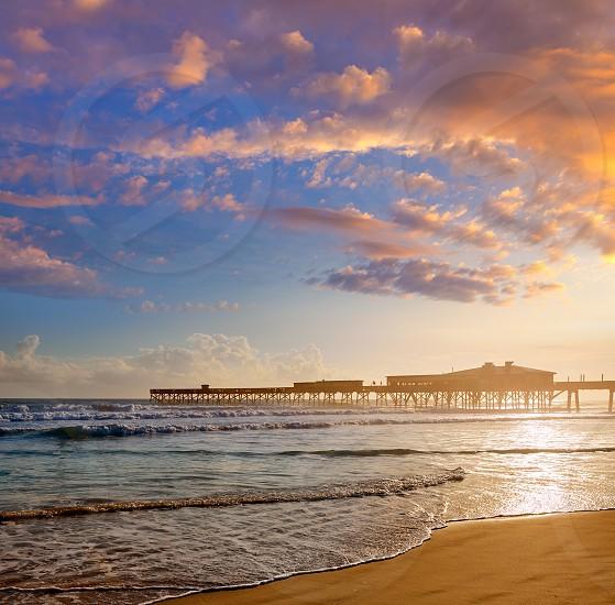 Daytona Beach in Florida shore with pier USA photo