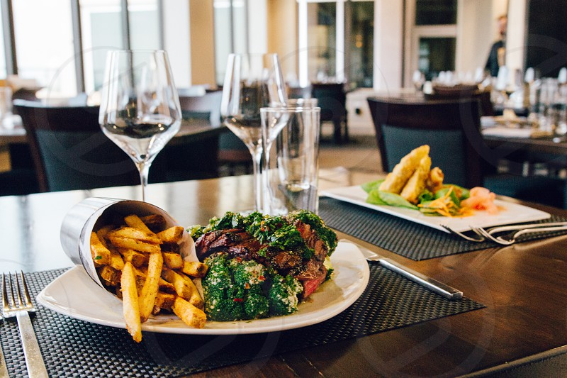 fries and green brown dish on plate photo