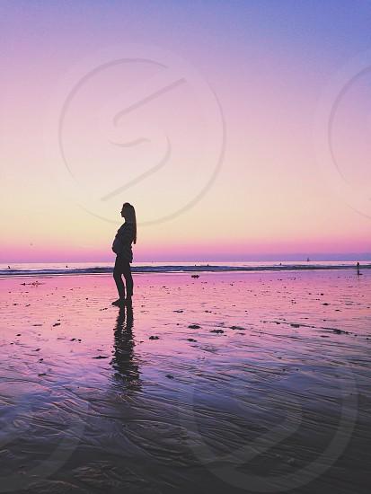 woman on seashore silhouette photo