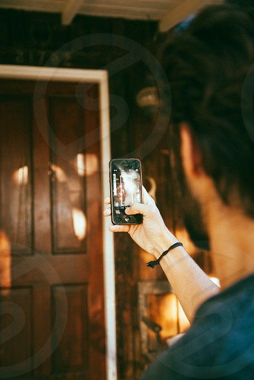 man taking a picture on door photo