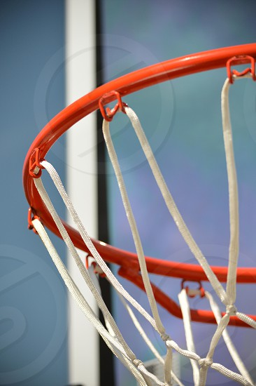 red basketball hoop with white net photo