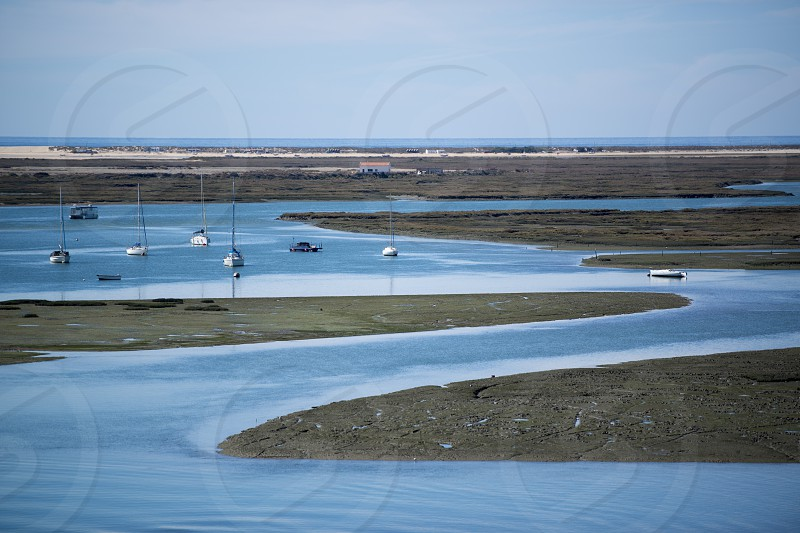 the Landscape of Ria Formosa at the coast of of Faro at the east Algarve in the south of Portugal in Europe. photo