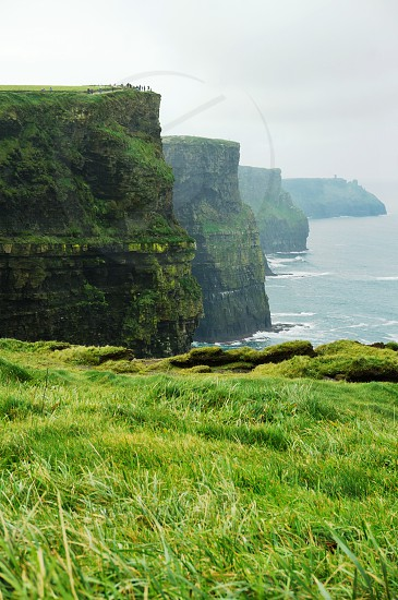Shades of green over the spectacular Cliffs of Moher in Ireland photo