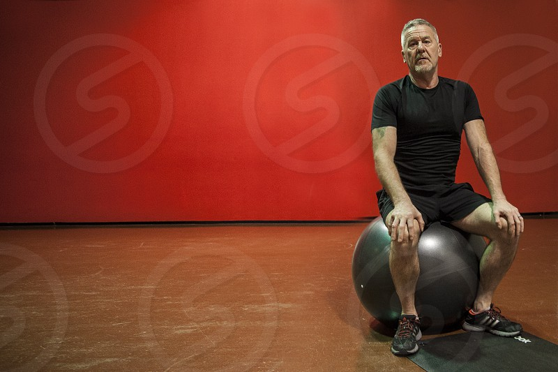 fitness gym workout exercise ball wall red photo