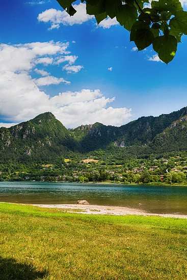 Amazing view landscape on beatiful Lake Idro in Brescia Province Lombardy Italy. Scenic small town with traditional houses and clear blue water. Summer vacation for tourists on rich resort in Italy. photo