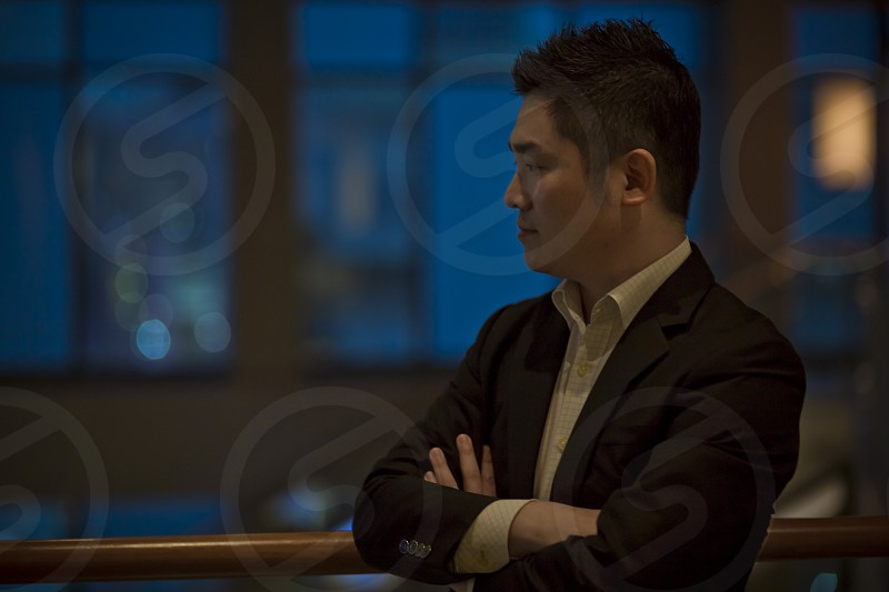 Portrait of Asian businessman wearing smart casual thinking posing photo