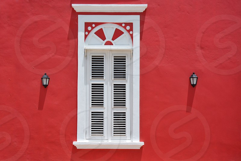 window in red wall photo